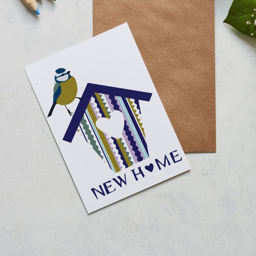 new home card with blue tit sitting on a house designed by Lorna Syson