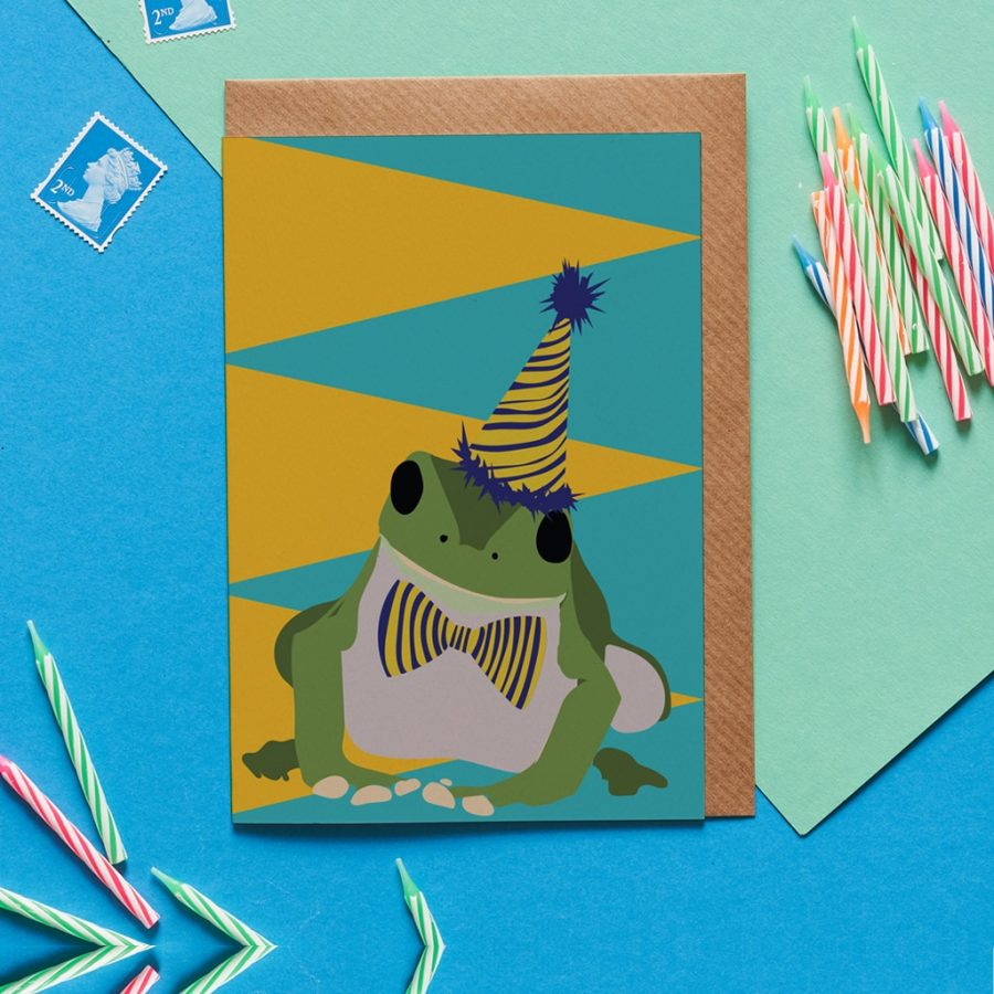 Herbert the frog wearing a party hat greeting card designed by Lorna Syson