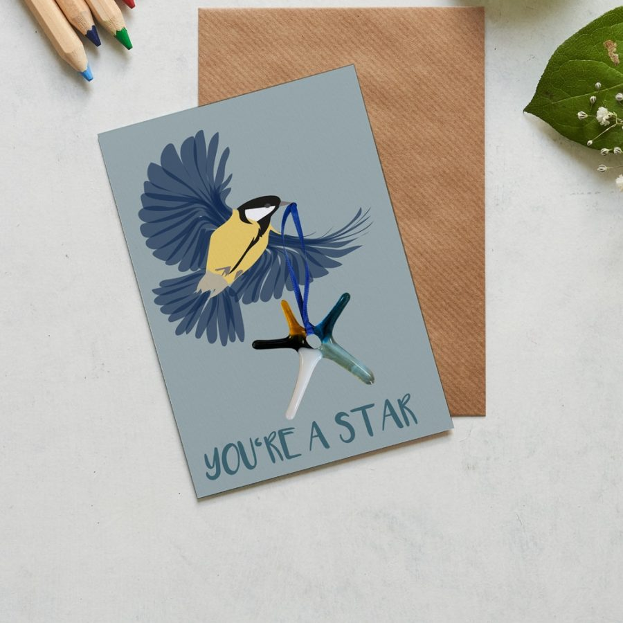 You're a star card featuring a hand made star by Sue King with a great tit flying across the page. Fantastic for a graduation card, well done card or new job card