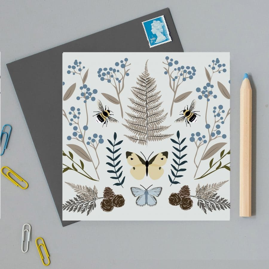 Illustrated greetings card with blue background ferns and butterflies