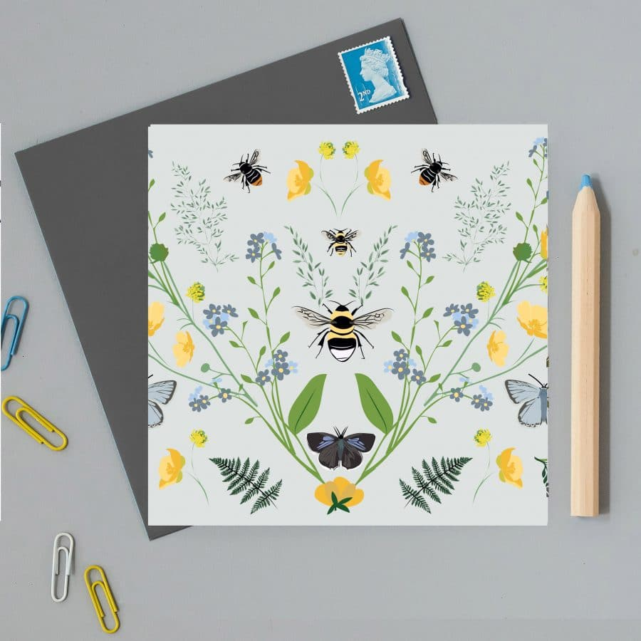 Illustrated greetings card with british flowers and bees