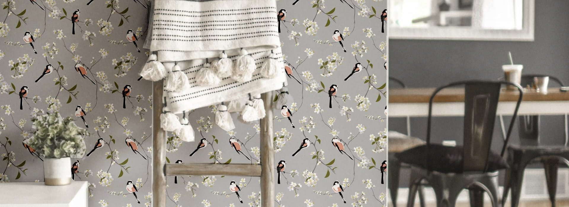 RSPB Blossom and Bird grey wallpaper designed by Lorna Syson