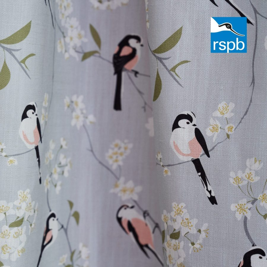 RSPB blossom and bird grey fabric designed by Lorna Syson