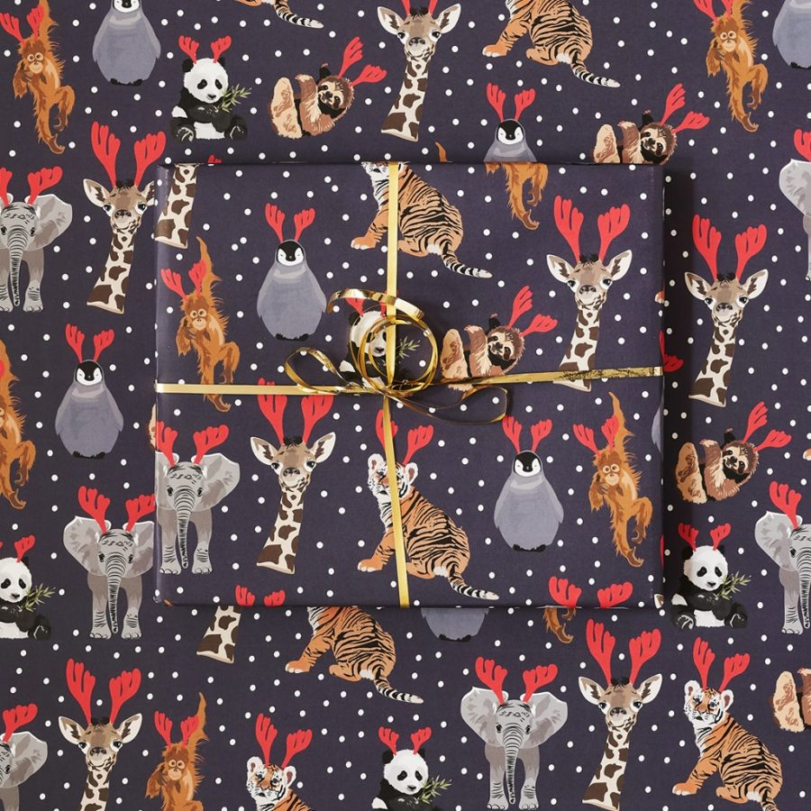 Go wild Christmas wrapping paper, panda, giraffe and penguin