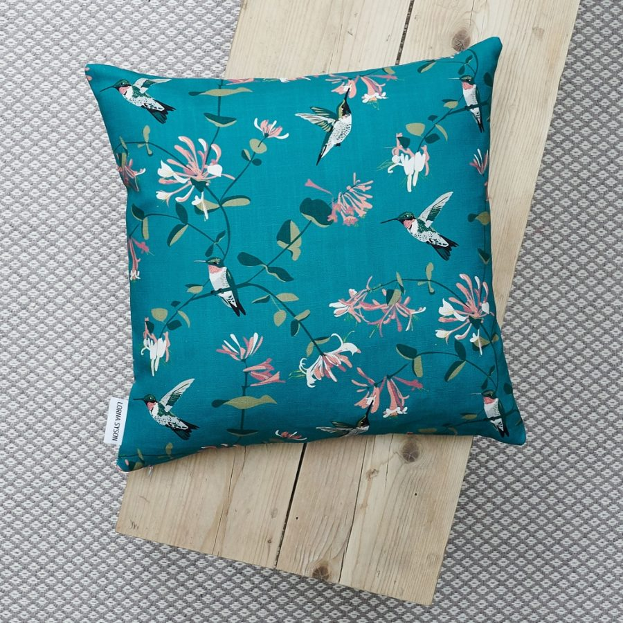 cushion, bird cushion, floral cushion, luxury cushion, designer cushion, uk designer, RSPB cushion, designer home, designer interiors, bird design, hummingbird teal design for the RSPB designed by Lorna Syson