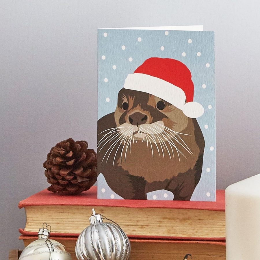 Christmas otter Christmas greeting card by Lorna Syson